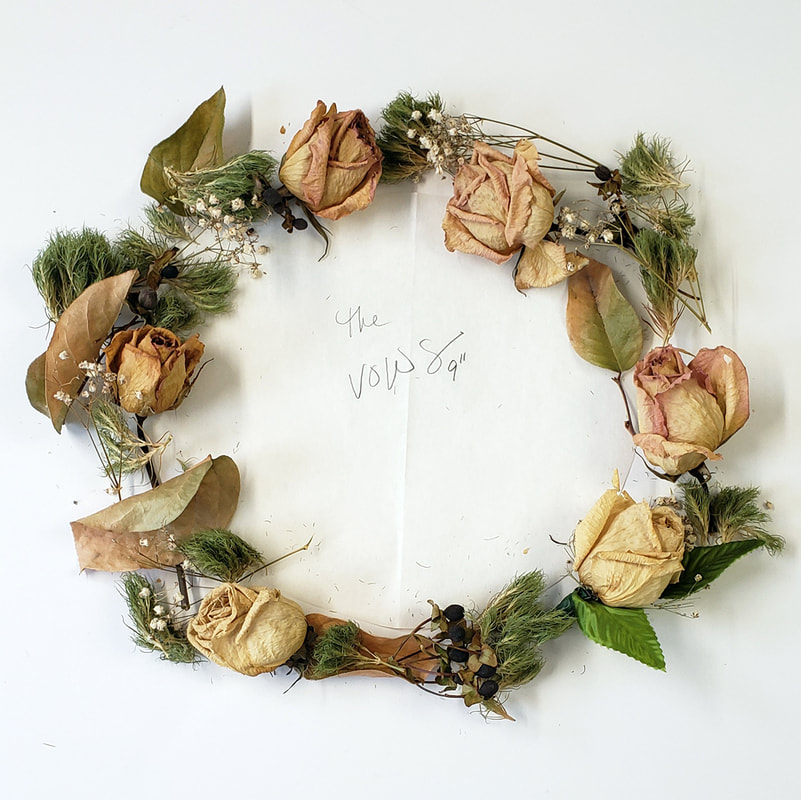 Finished wreath of dried wedding flowers for a shadow box.