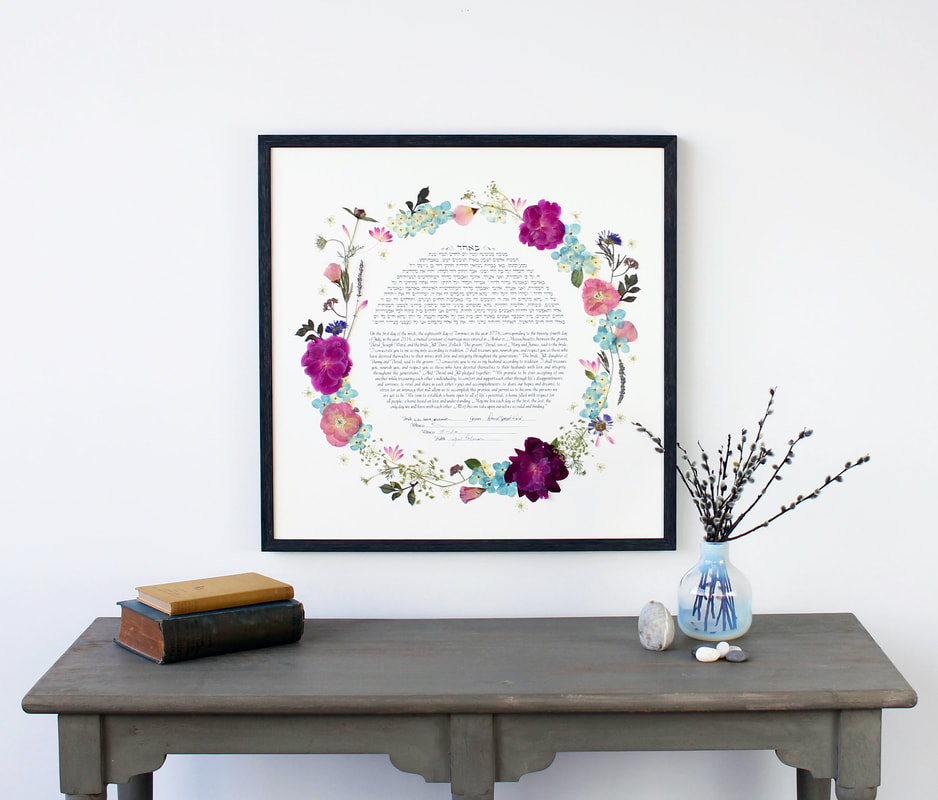This fine art ketubah displays your wedding bouquet in your home for years to come.