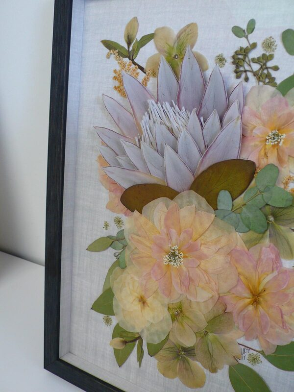 Pressed wedding flowers with eucalyptus, protea, queen anne's lace, in a collage.