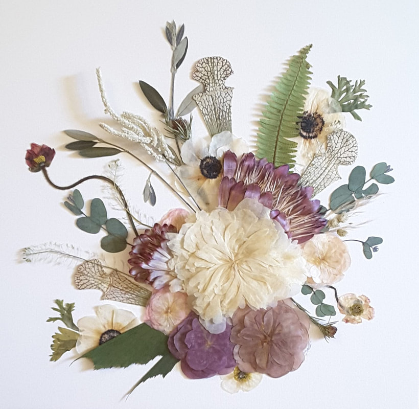 Botanical collage of pressed wedding flowers with ranunculus, protea and pitcher plants.