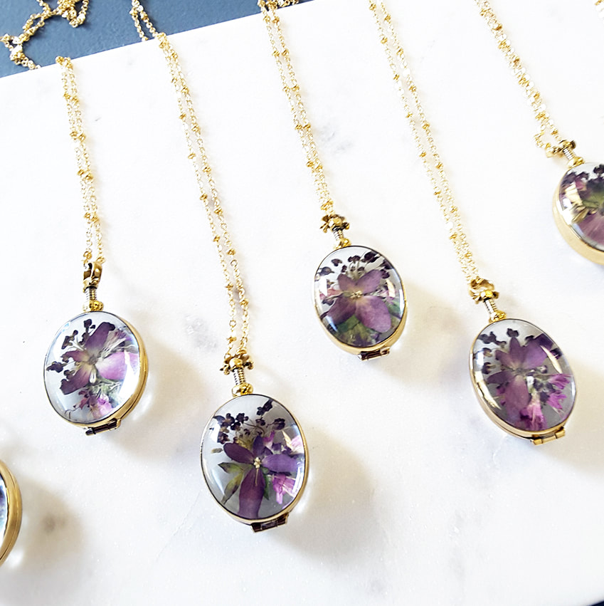 Save your wedding flowers in a locket. Imagine giving this gift to your mom after your wedding!